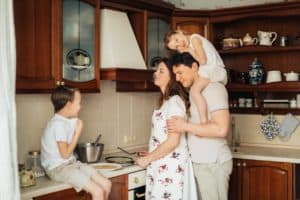 Family preparing a meal in the kitchen together